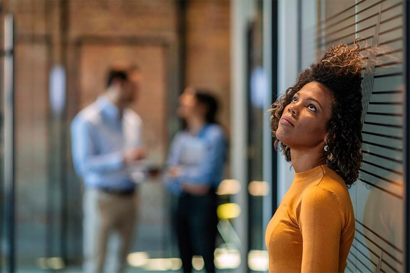 female employee dealing with redundancy   How does redundancy work - IRIS